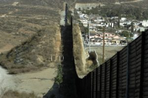 A view of the wall that separates the US and Mexico in San Ysidro, California, 27 January 2006. US Senators approved 17 May 2006, a measure for the construction of a 600-km (370-mile) triple-layered fence along the US border with Mexico, and the measure also calls for the installation of vehicle barriers on a 800-km  (500-mile) stretch of the 3200 kms (2000 mile) long frontier. / AFP PHOTO / HECTOR MATA